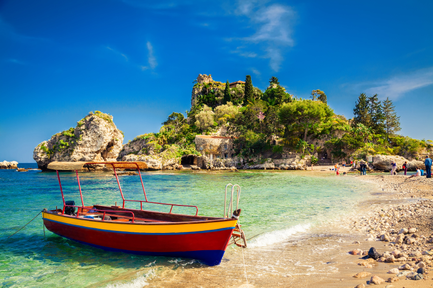 small boat for excursion in front of the island Isola Bella at Taormina, Sicily
